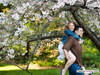 Piggy back ride under cherry blossoms
